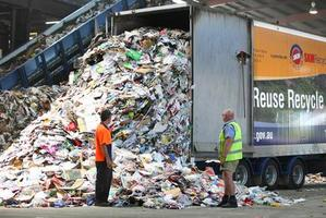 Another load of refuse arrives at a sorting plant.